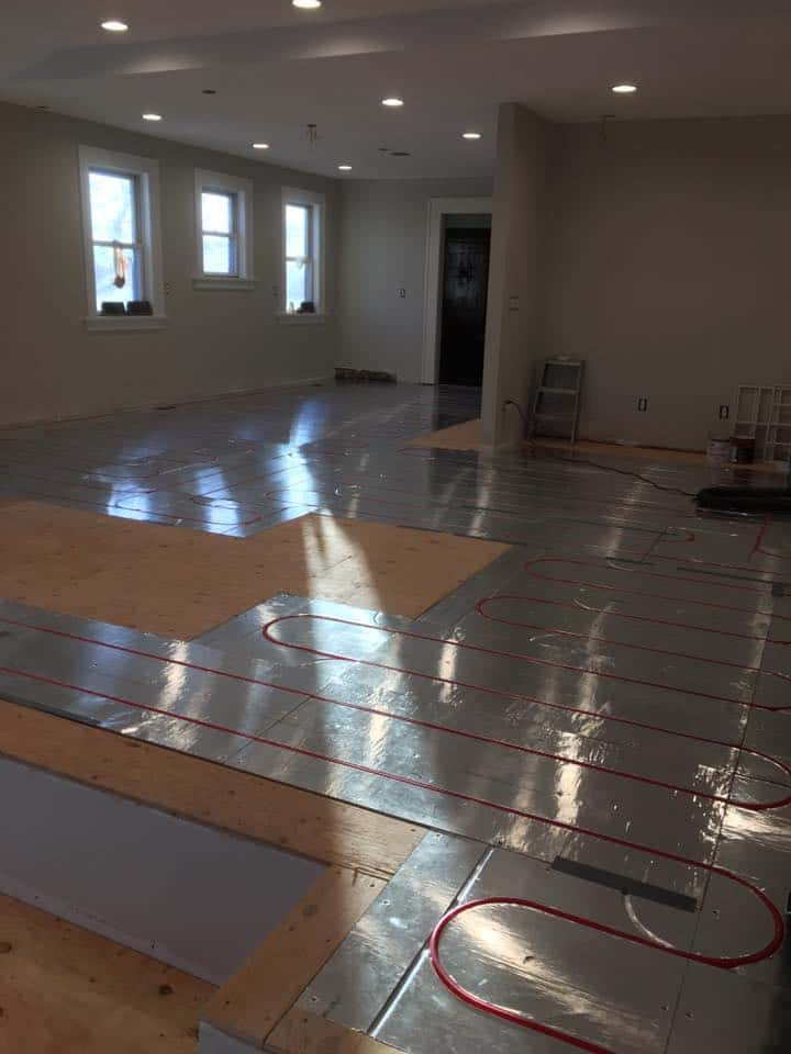 new heated floor being laid